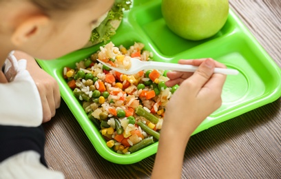 Child with healthy food for school lunch at desk, closeup