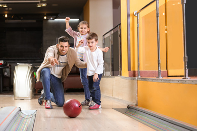Happy family spending time together in bowling club