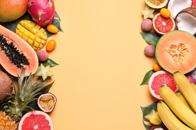Different exotic fruits on beige background, flat lay. Space for text