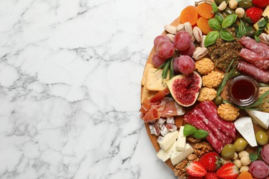 Different tasty appetizers on white marble table, top view. Space for text