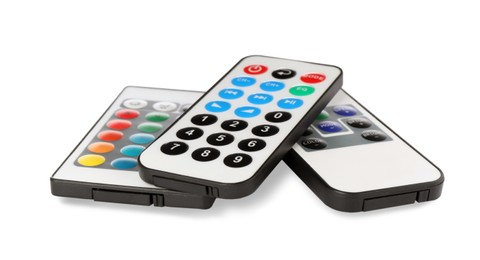 Different modern remote controls on white background