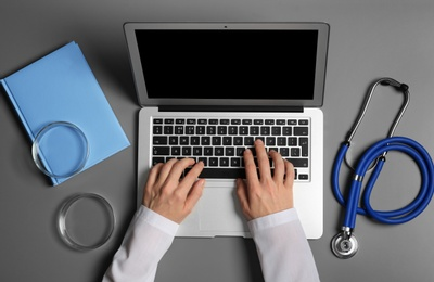 Student with modern laptop and medical stuff at table, top view