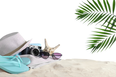 Composition with beach objects on sand against white background. Space for text