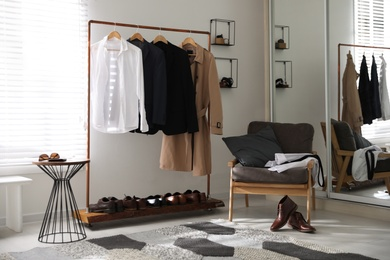 Dressing room interior with clothing rack and armchair