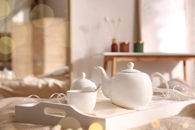 White tray with ceramic tea set in room
