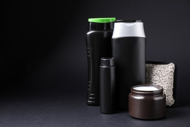 Set of different men's cosmetic products on black background. Space for text