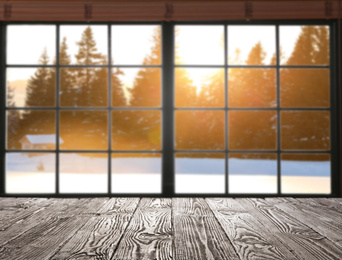 Empty wooden table and window with beautiful view indoors