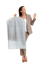 Young woman holding garment cover with clothes on white background. Dry-cleaning service
