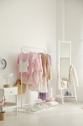Dressing room interior with clothing rack and mirror