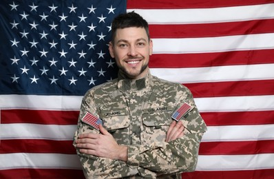 Portrait of happy cadet against American flag