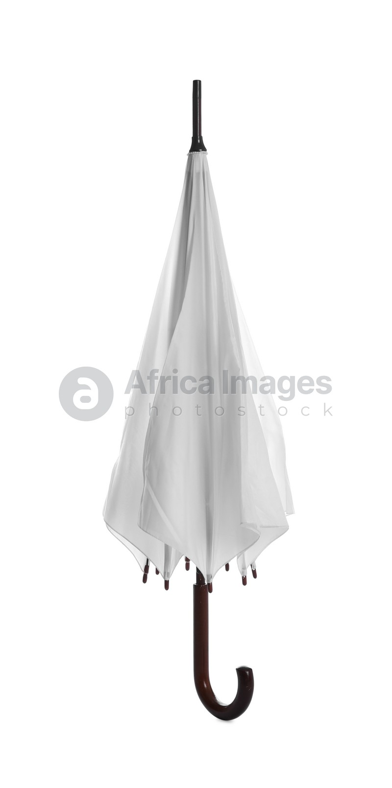 One closed straight umbrella isolated on white