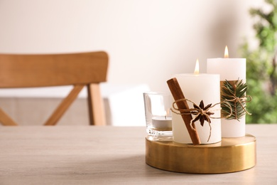 Decorated scented candles on table indoors, space for text