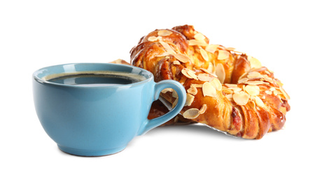 Delicious pastries and coffee on white background