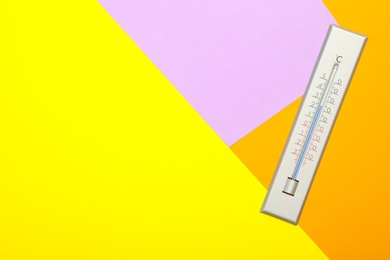 Weather thermometer on color background, top view. Space for text