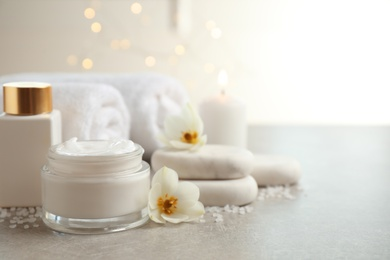 Spa composition with skin care products on light background, space for text