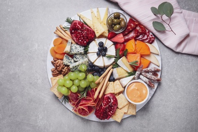 Assorted appetizers served on light grey table, flat lay