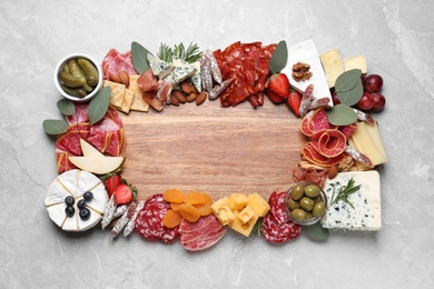 Assorted appetizer served on light grey table, top view. Space for text