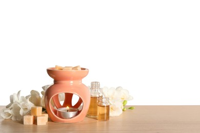 Composition with aroma lamp on wooden table against light grey background, space for text