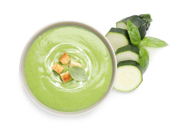 Tasty homemade zucchini cream soup isolated on white, top view