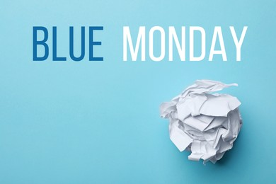 Crumpled sheet of paper and text Blue Monday on color background, top view