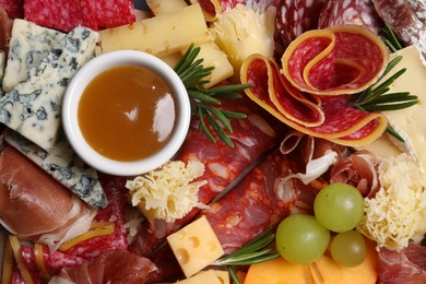 Different appetizers with dip sauce as background, top view