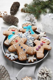 Delicious Christmas cookies, pine cones and fir branches on table