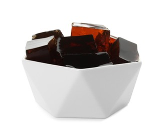 Delicious grass jelly cubes in bowl on white background