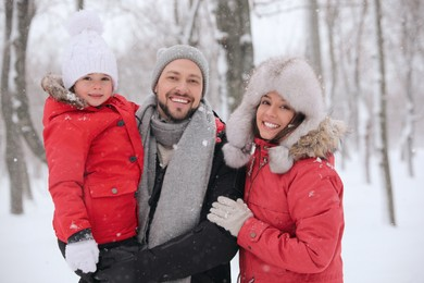 Portrait of happy family outside on winter day. Christmas vacation