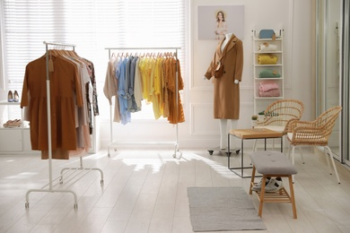 Stylish women's clothes and accessories in modern boutique