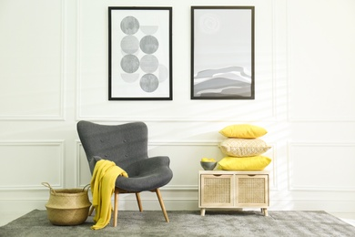 Stylish living room with armchair. Interior design in grey and yellow colors