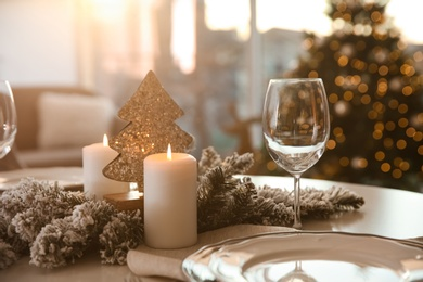 Elegant table setting with Christmas decor indoors