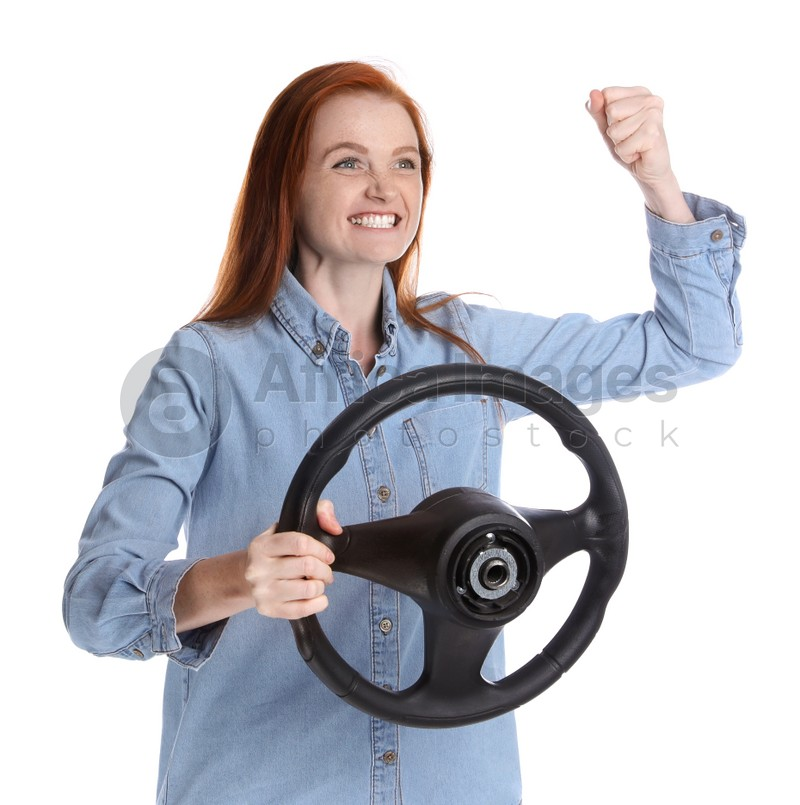 Emotional woman with steering wheel on white background