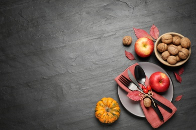 Festive table setting on black background, flat lay with space for text. Thanksgiving Day celebration