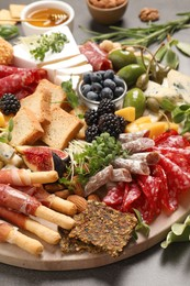 Many different tasty appetizers on table, closeup