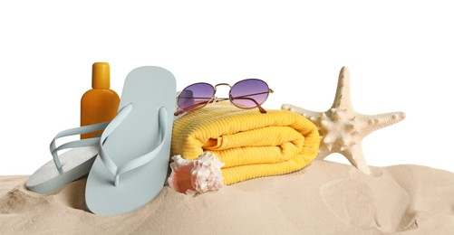 Different beach objects on sand against white background