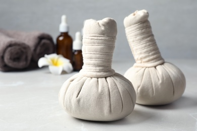 Herbal bags for spa massage on table