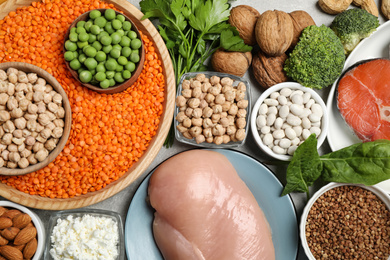 Different products rich in protein on table, flat lay
