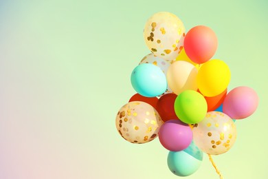 Many bright balloons on color background, space for text. Summer party. Summer party