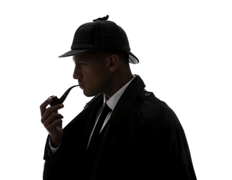 Old fashioned detective with smoking pipe on white background