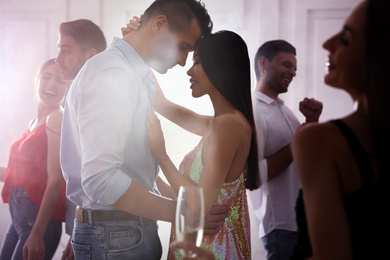 Lovely young couple dancing together at party