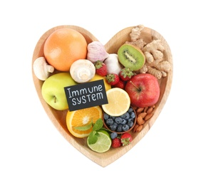 Heart shaped tray with healthy products and text Immune System on white background, top view