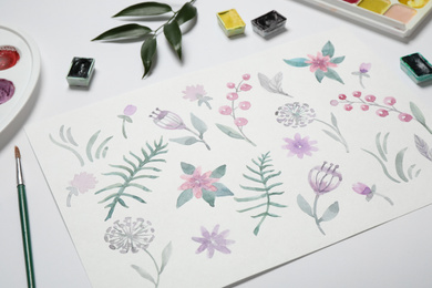 Composition with beautiful floral picture and watercolor paints on white background