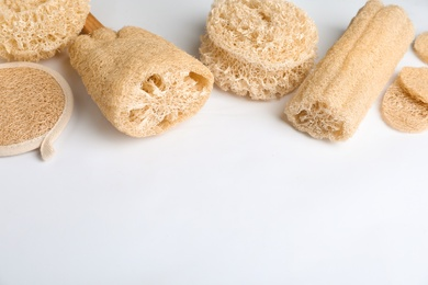 Natural shower loofah sponges on white background