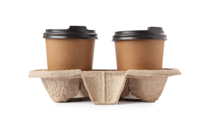 Takeaway paper coffee cups in holder isolated on white