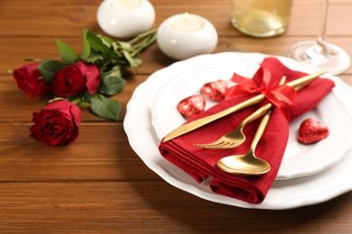 Beautiful table setting for Valentine's Day dinner on wooden background, closeup