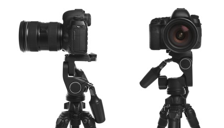 Modern tripods with professional cameras on white background