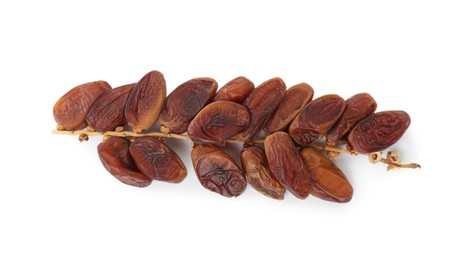 Sweet dates on branch against white background, top view. Dried fruit as healthy snack