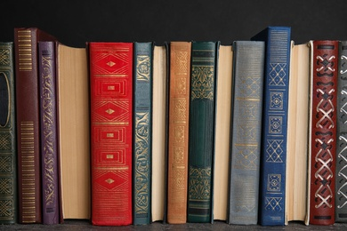 Stack of hardcover books on grey stone table