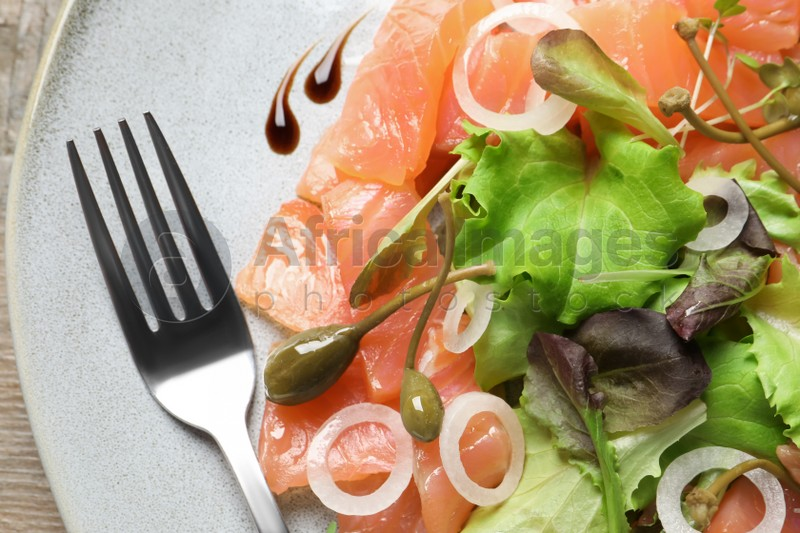 Delicious salmon carpaccio served on table, top view