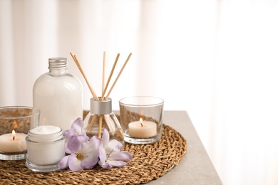Composition with skin care products and reed air freshener on grey table, space for text